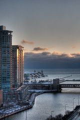 Chicago Winter Sunrise (Doc List Photography) Tags: bridge winter sky usa cloud snow chicago reflection building window water sunrise river illinois unitedstates ripple il hdr snaptweet