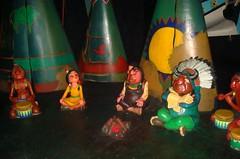 Natives of Neverland (partyhare) Tags: fire village drum indian chief peterpan disney disneyworld indians teepee wdw waltdisneyworld neverland tigerlily magickingdom fantasyland darkride peacepipe peterpansflight