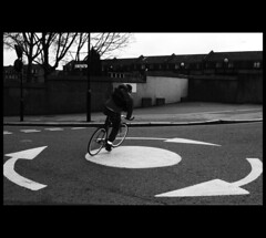 In the Round (Nrbelex) Tags: england blackandwhite bw white black london monochrome bicycle canon blackwhite 2470mml europe roundabout streetphotography monochromatic cycle dslr bandw nottinghill streetscenes cycler trafficcircle londonist londonengland 2470mm 2470mmf28 xti shootexperience nottinghilllondon ef2470mm 400d shootexperiencecom nrbelex shootportobello