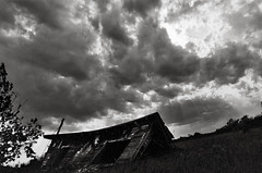 let's go there (ring fingaz) Tags: county door blackandwhite bw sun house storm film broken field mystery wisconsin clouds contrast rural blackwhite decay fallen torn wi doorcounty dilapidated tattered dilapidatedhouse decrepid sunthroughclouds doorcountywi doorcountywisconsin midwestrural sunraysthroughclouds