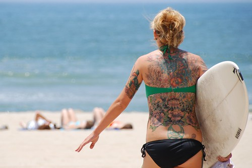 Tattoo's art back for girl at beach