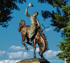 Cowboy On Bucking Broncho Statue In The Town Square Park Of Jackson, Wyoming (ConstantineD) Tags: statue nikon cowboy d70s jackson bronzestatue wyoming 18200 jacksonhole wy 18200mm 18200vr buckingbroncho