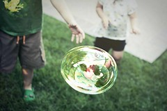 bubble chase (greenwatermelon) Tags: summer kids lomo bubbles games bubble chase 35mmf18 d40 coffeeshopaction