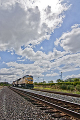 Railway (tomazws) Tags: railroad sky clouds train track cloudy rail wideangle freighttrain cargotrain canonrebelxs tokina1116mmf28