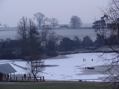 Family walking across the frozen lake. (Rachael Hickling) Tags: trees winter england lake snow ice nature frozen kent tunbridgewells pembury supershot dunorlan