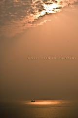 Stranded (.ranak) Tags: light sun clouds ship bayofbengal