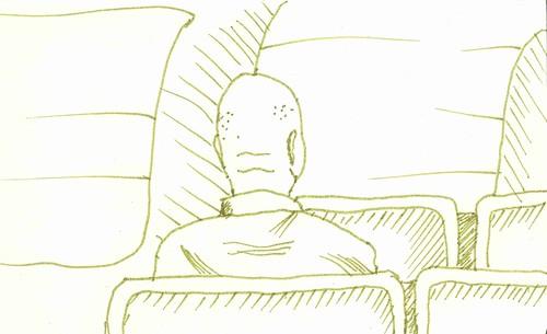 bald man on train