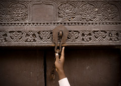 Lock the door when you leave please, Bagamoyo, Tanzania (Eric Lafforgue) Tags: voyage africa door wood travel people house building horizontal architecture tanzania outdoors photography wooden carved photographie lock entrance culture carve doorway human porte stonetown maison oldbuilding oneperson bois swahili afrique eastafrica bagamoyo entree pleinair tansania buildingentrance tanzanya humain fermeture tanzanie exterieur 2850 colorpicture photocouleur decrepi tansaania tanzanija afriquedelest танзания タンザニア colourpicture تنزانيا 탄자니아 unepersonne τανζανία sculptee 坦桑尼亞 tanzānija танзанија tanzāniyā tanżanja