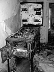 (kathryn watney) Tags: old white house black abandoned wire mess machine pinball delapidated