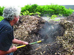 Steam from the heat of decomposition rises from Sweet Water's compost. ~photo Casey Twanow