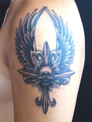 cross tattoo with wing