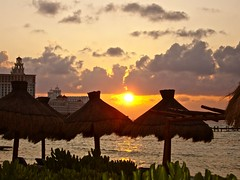 Sun over the water (Dave DiCello) Tags: ocean sunset gulfofmexico water clouds point evening shoot pentax dusk 7 resort huts dreams cancun caribbean optio s7 mexicovacation cancunvacation dreamvacation cancunmexico dreamscancun sunriseocean dreamsresortandspa dreamspalmbeach beachorseaoroceanorsandorclouds abeachinthemorning imagesunoverwater evad310 dreamsresortinmexico davedicello