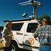 Reporter on location with cameraman and News Cruiser