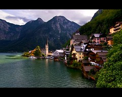 Goodbye Hallstatt (Nathan Bergeron Photography) Tags: flowers mountains green church water architecture umbrella landscape geotagged boats austria europe artist cathedral spire getty balconies picks easterneurope kayaks centraleurope hallstatt upperaustria christuskirche austrianalps emeraldwater hallstttersee aplusphoto churchofourlord yearinfrance 18122009 dachsteinsalzkammergut nordichomes hallsttterlake geo:lat=47565349 geo:lon=13650383