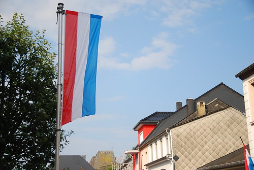 Luxembourg flag and banner in Wiltz' Grand-Rue