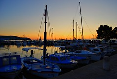 Izola (Sareni) Tags: trees light sunset sea summer vacation sky people tree water colors reflections boats lights evening boat dock nikon ship flag july explore more slovenia sail motor slovenija 2009 voda adriatic isola jadran twop izola d60 nikond60 hiil jadranskomore sareni