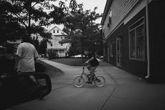 _MG_1672-5 (k.a. gilbert) Tags: street urban bw bicycle kids walking driveby providence riding pedestrians 116 fromcar lightroom tokina1116mmf28