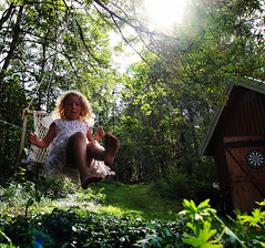 vilma (sollerman) Tags: trees summer sun green girl backlight child play skirt swing summerhouse lensreflection