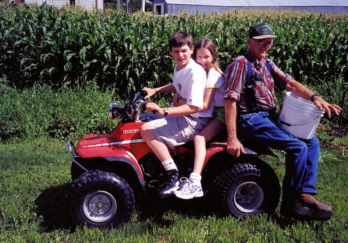 Will (15), Christina (10) and Grandpa Glenn on the way to pick potatoes from Grandma and Grandpa's garden, 2000.
