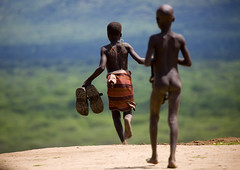 Going to Omo river to wash the white man shoes (Eric Lafforgue) Tags: kara river back kid shoes child artistic dam run tribal wash ornament dos bodypainting ethiopia tribe rite enfant karo barrage tribo adornment pigments tribu omo eastafrica thiopien etiopia ethiopie etiopa 5158  etiopija ethiopi  etiopien etipia  etiyopya  nomadicpeople      salinicostruttori    gibeiiidam gibe3dam bienvenuedansmatribu peoplesoftheomovalley