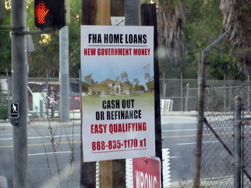 a sign advertising FHA home loans