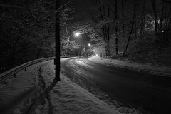 Deeper into that January night (Nino.Modugno) Tags: road lighting city winter blackandwhite bw snow ny newyork lynch streets blancoynegro lamp night season noche blackwhite scenery moody image nacht streetlamp snowy hometown yo january illumination atmosphere eerie depthoffield spooky suburbs snowing suburb roads curve yonkers 2009 soe ambience lynchian westchester snowcoveredtrees snows googlesearch mercurial illuminating yahoosearch aolsearch curveintheroad heavywithmood palmerroad nikond40 cedarknolls southernwestchester ninomodugno popularimages thefourthlargestcityinnewyorkstate eugenelapia ebbandflowoflightanddarkness cedarknollyonkers thisislocatedinbronxvillebutwithayonkerszipcode yawnkerz