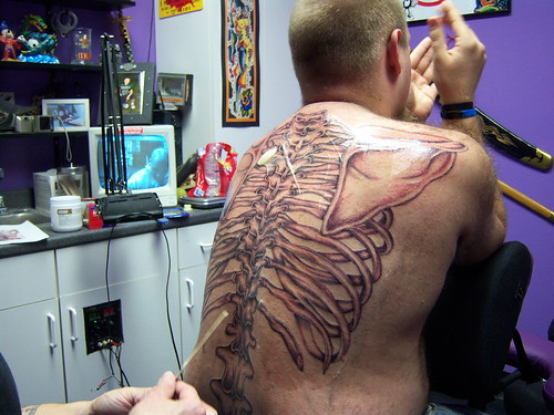 Anatomical back skeleton tattoo