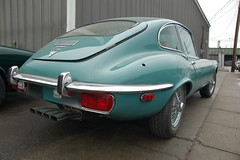Old Jaguar E-type sports car: back fender & ex...