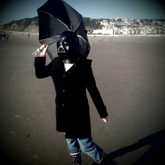I iz Vader on SF beach (cindyli) Tags: sanfrancisco beach umbrella onthego oceanbeach darthvader iphone cindyli rainboots iphone3g