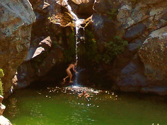 touching the fall (egotoagrimi) Tags: boy island ikaria canyon greece waterhole livada angelolivada agrimi angelspool