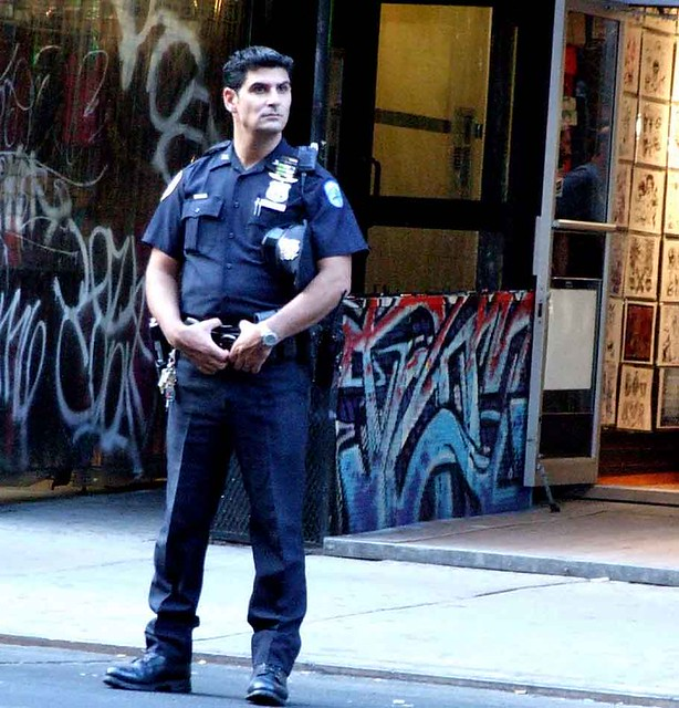 Handsome cop protects St. Marks Place.