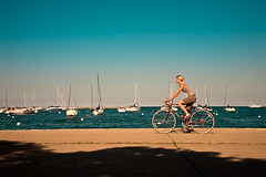 What a beautiful day to be free... (Lidia Camacho) Tags: shadow summer sky usa chicago hot water girl bike bicycle boats illinois seaside alone wheels sunny lakemichigan riding blond heat summertime cloudless