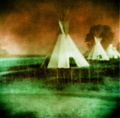 Suburban Development Council (Dead  Air) Tags: sky blur grass manipulated washington holga indian surreal nativeamerican overexposed armageddon sciencefiction campground toppenish teepees postapocolyptic abigfave yakamatribalcenter