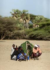 Gabbra people crouching in the desert - Kenya (Eric Lafforgue) Tags: africa kenya culture tribal tribes afrika tradition tribe ethnic ramadan tribo headdress afrique headwear ethnology headgear tribu eastafrica quénia 6335 lafforgue gabbra ethnie ケニア quênia كينيا 케냐 кения keňa 肯尼亚 κένυα кенија кенијa