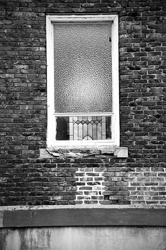 stained through the broken window