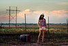 Same Old Paradise. (The Vision Beautiful) Tags: sunset red portrait white girl hat shirt clouds fence wire texas fields shorts brunette suspenders plains barbed striped trilby suitcases ashleyskillman