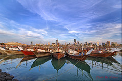 boats (Ahmad Al ameeri) Tags: sky reflection clouds boats zoom ama     almosak