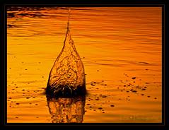 Water Fire (Kuzeytac) Tags: red sea fab orange color colour reflection nature water yellow sunrise turkey trkiye turkiye aegean explore su crown splash reflexions deniz leyla assos canakkale ege sar lsi yansma krmz portakal renk doa gndoumu turuncu the4elements abigfave canoneos400d canoneosdigitalrebelxti anawesomeshot superaplus aplusphoto ultimateshot infinestyle fbdg kuzeytac 100commentgroup aqualityonlyclub
