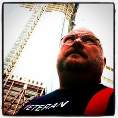 at the Freedom Tower (wooferSTL) Tags: nyc vacation square manhattan worldtradecenter 911 squareformat groundzero freedomtower lomofi iphoneography instagramapp uploaded:by=instagram foursquare:venue=4b2d321af964a520b4d024e3