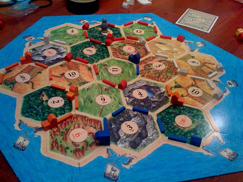 Katie = undefeated two time champion of Settlers of Catan. Just realizing how imporant these 'Development Cards' are.