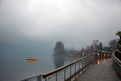 B6M2J1 - Lights on the Bridge (thomaspetermueller) Tags: houses winter light sky sun mist lake misty fog by contrast landscape lago lights boat is mood sailing view near rich hidden anchor stillness inviting touched distant passageway the somehow dorta completes welllit a pettenasco