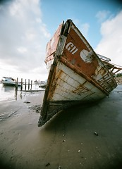 Z-12  II   (abandoned) (Ricardo S Oliveira) Tags: sunset abandoned film lens boats fishing nikon kodak sigma 1020mm nikonf6 noritsu ricardosoliveira