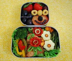 Happy Face and Flower Bento (sherimiya ) Tags: flowers school flower cute chicken fruits face fun lunch happy golden kid healthy funny purple sweet tomatoes plum strawberries broccoli potato homemade asparagus grapes peppers bento carrots raspberries roasted obento shoyu peapods satsumaimo firstgrader sherimiya