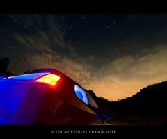 [Long Exposure tude #2] Clouds are coming (Luca Cesari Photography) Tags: longexposure trees sky car night canon stars punto blu flash gel tude efs1022mm 400d lucaeos