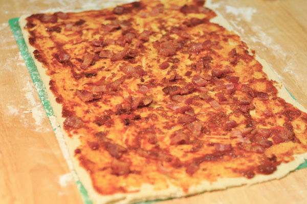 dough for feuilletage folled and folded  four times for 12 layers covered with chipotle in adobo and bacon bits