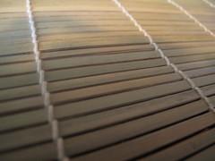 Flat-sided sticks on sushi mat