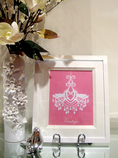 Pink and white chandelier print from Ish and Chi's <a href=