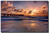Rough Waters (Fraggle Red) Tags: ocean pink orange sun clouds sunrise dawn pier waves florida explosion windy stormy jpeg atlanticocean hdr fishingpier violent pompanobeach oceanspray exposureblending photomatix digitalblending 3exp fineartphotos golddragon abigfave canonef1022mmf3545usm browardco dphdr grouptripod