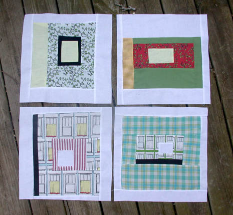four wonky log cabin blocks