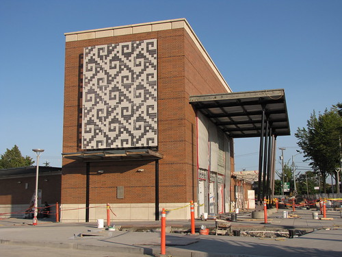 The art outside the station has begun to be installed. The work on the north side of the building  is by artist Carl Smool.